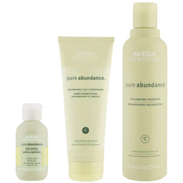 Kit volumizzante Pure Abudance di Aveda costituito da shampoo, balsamo e trattamento per capelli Abundance