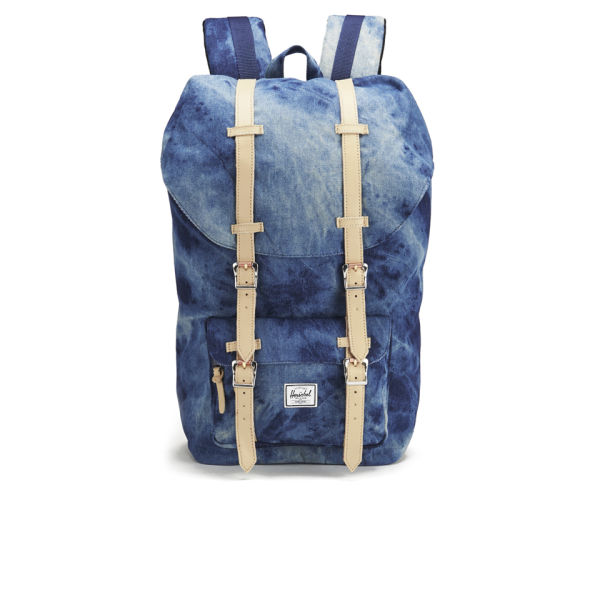 Blue washed denim mini backpack with adjustable straps, front zipper pocket and zipper closure. Personalize your bag with pins, patches, clip-ons and more! (Not included - but we know where you can find 'em!) 10