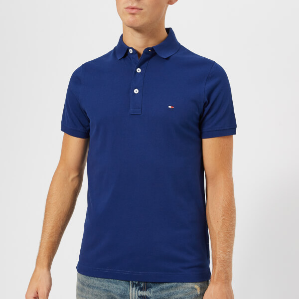 cf3841315ee94 Tommy Hilfiger Men s Tommy Slim Fit Polo Shirt - Blue Depths  Image 1