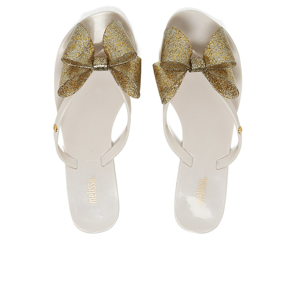 8d59d0939b01a2 Melissa Women s Harmonic Glitter Bow Flip Flops - Ivory