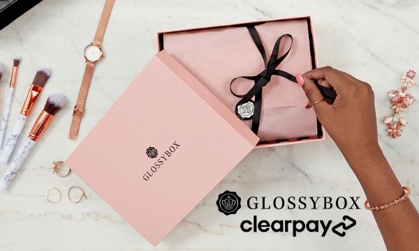 Pink GLOSSYBOX on white marble background, with GLOSSYBOX and Clearpay logo.