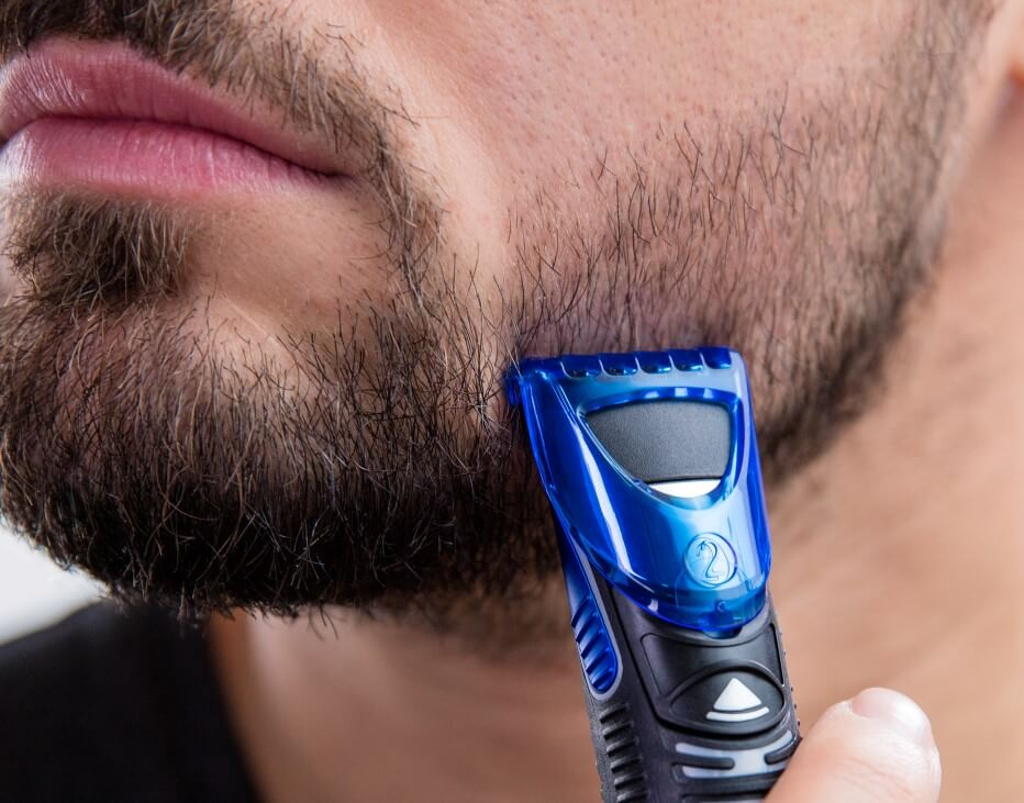 Man trimming beard with Gillette Styler.