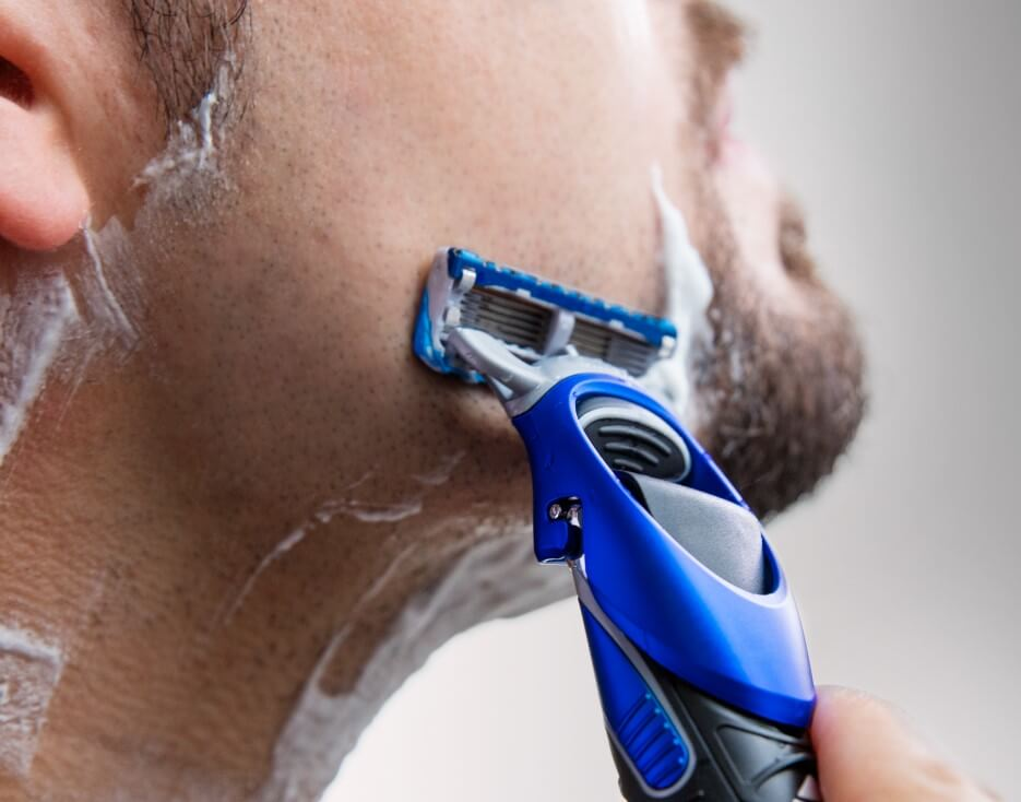 Man shaving with Gillette Styler.