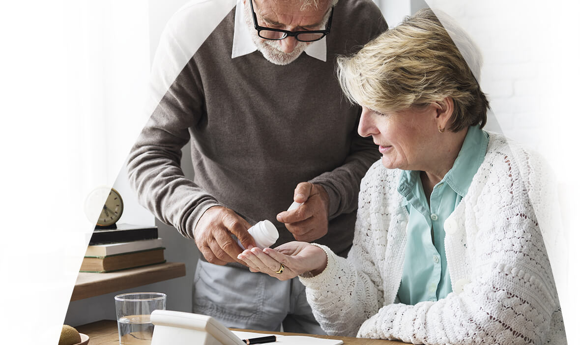 Old couple taking tablets.
