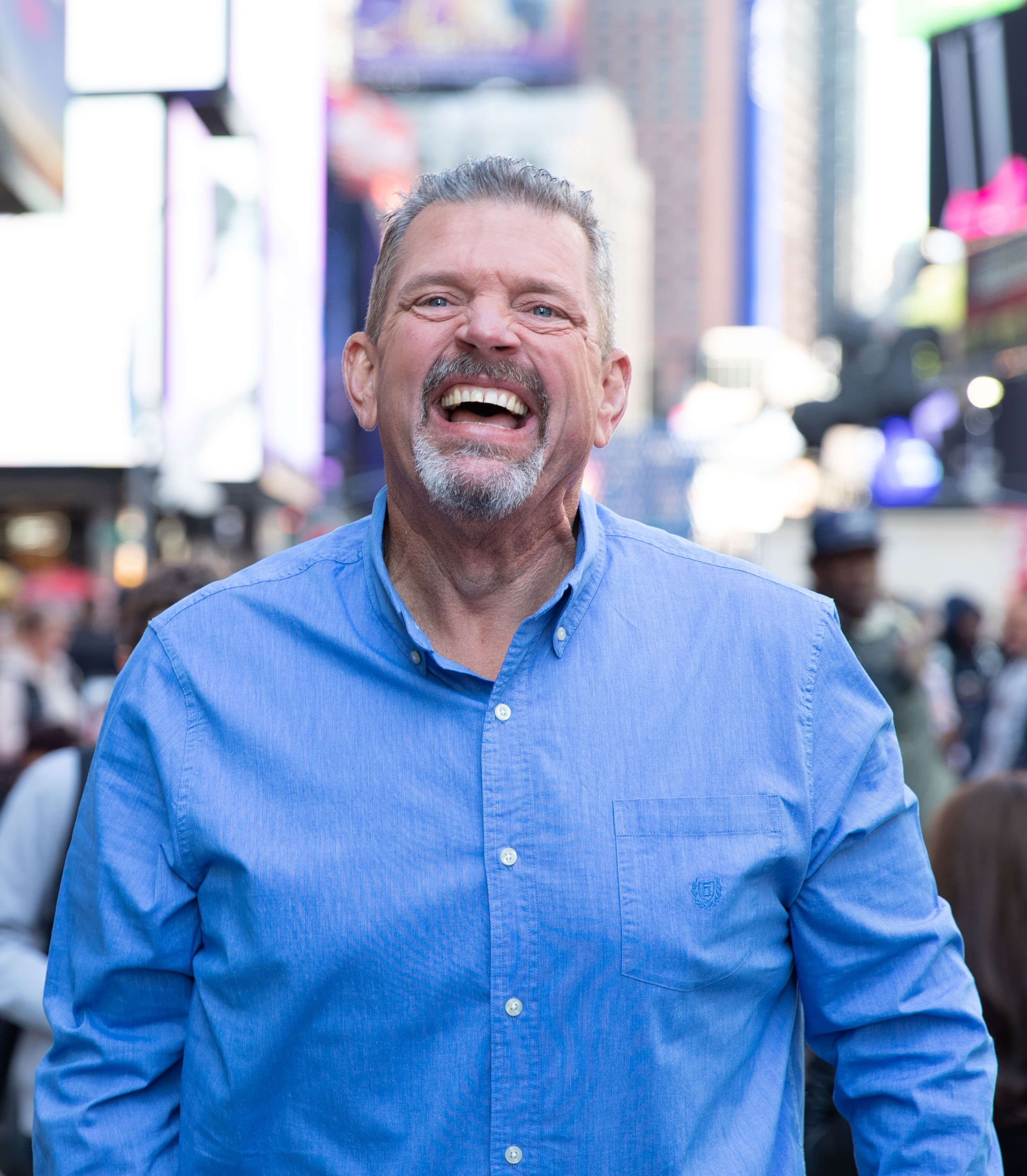Image of a man laughing in a city