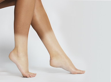 before and after shot of legs following a spray tan