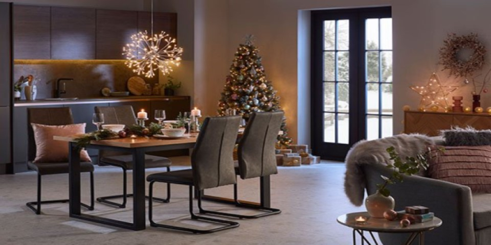 Living room decorated with lights and dining table laid out
