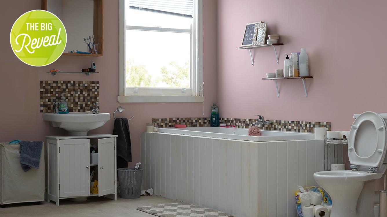 Unrennovated bathroom, pink walls white furniture, badly finished.