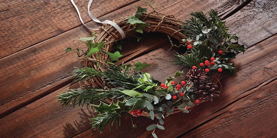 Wooden christmas wreath with holly