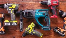 Variety of different power tools on a wooden worktop