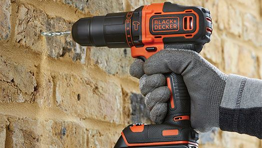 Power Tool drilling into brick wall