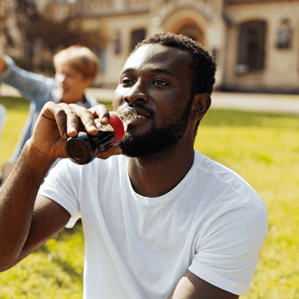 Man enjoying a bottle of Coca-Cola