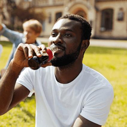 Man enjoying a bottle of Coca-Cola