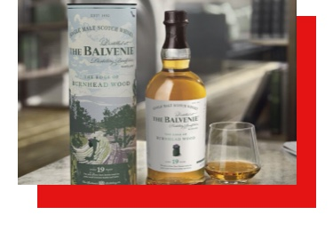 The Balvenie Whisky, served straight in a glass, accompanied by the bottle and its case