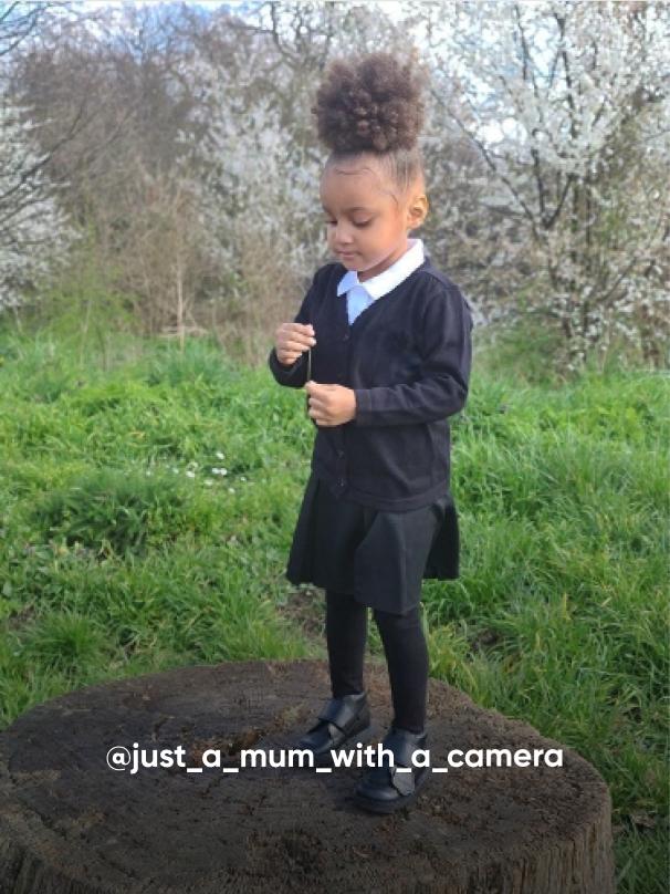 girl standing on a tree - Visit Kickers Kids Instagram