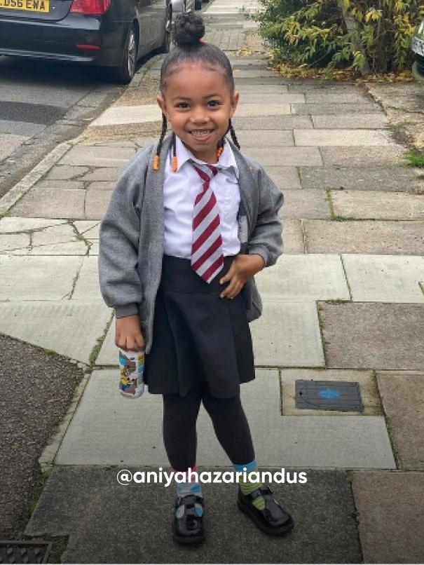 girl smiling on the street - Visit Kickers Kids Instagram