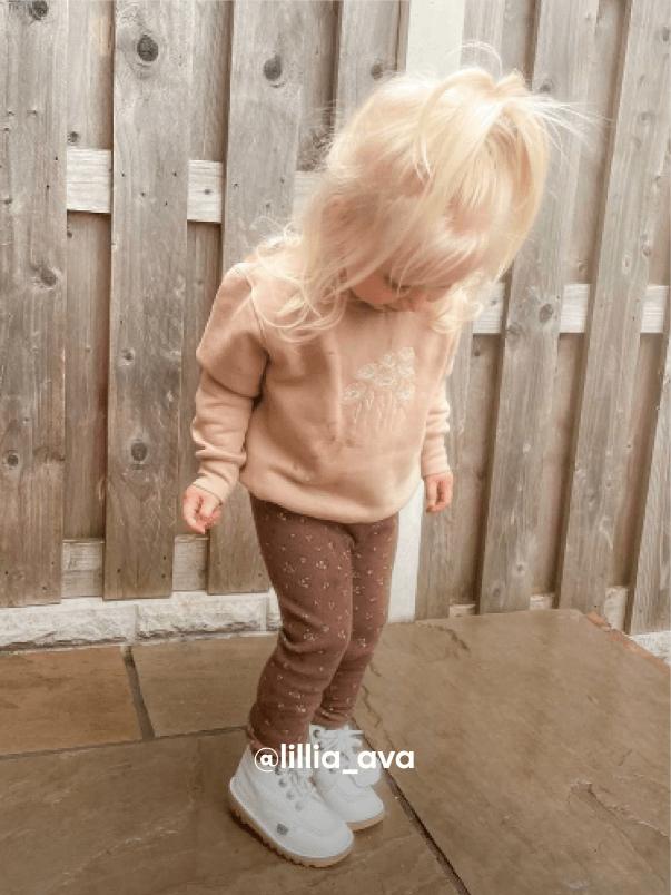 Girl Looking Down at her Feet - Visit Kickers Kids Instagram