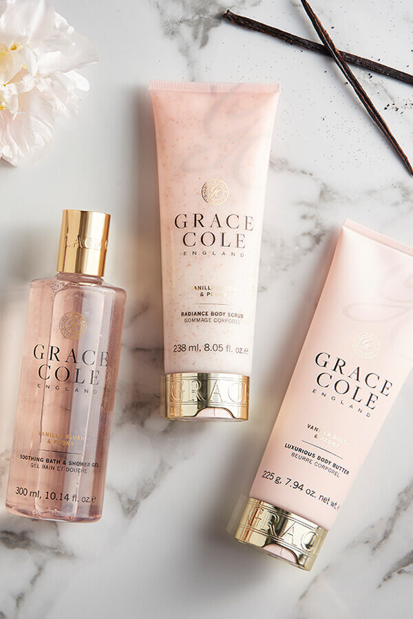 An image displaying 3 pink Grace Cole Products; a shower gel, a body scrub and a body butter.