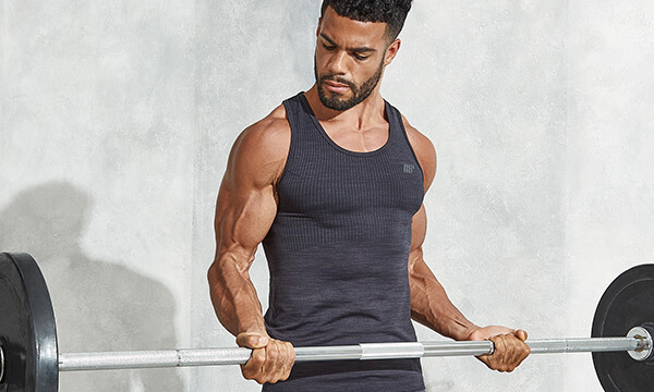 Athletic man doing a barbell curl